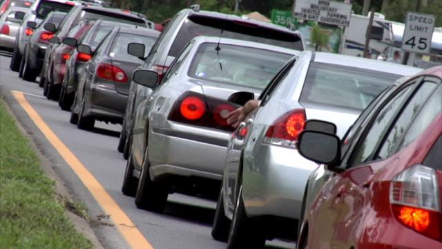 gridlock traffic_dutch angle - trafik sıkışıklığı stok videoları ve detay görüntü çekimi
