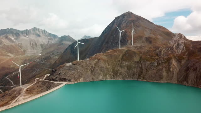 Griessee reservoir on the Nufenen Pass with wind turbines