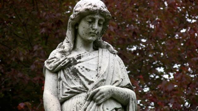 Grieving cemetery statue. Medium shot. video