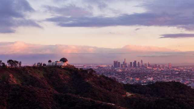 griffith observatory and downtown los angeles day to night sunset - california video stock e b–roll