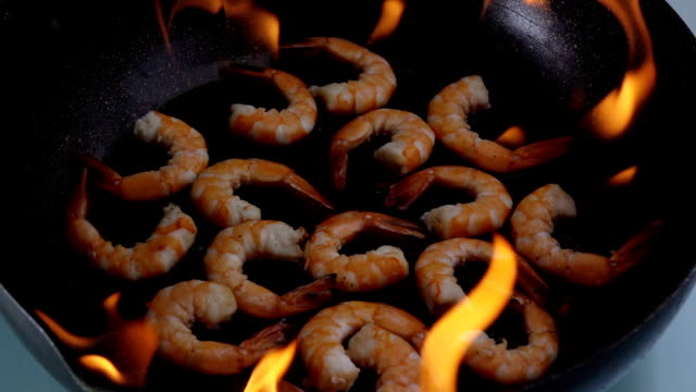 grill shrimp , barbecue sea food on fire flaming slow motion background.