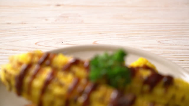 grilled and barbecue corn with bbq sauce