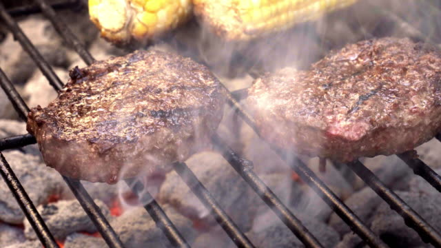 Grilled Beef Hamburgers on an old-fashioned Charcoal Barbecue, Corn-on-the-cob Grilled Beef Hamburgers on an old-fashioned Charcoal Barbecue with charred corn on the cob ground beef stock videos & royalty-free footage