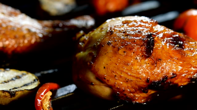 Grilled chicken legs on the flaming grill (slow motion) video