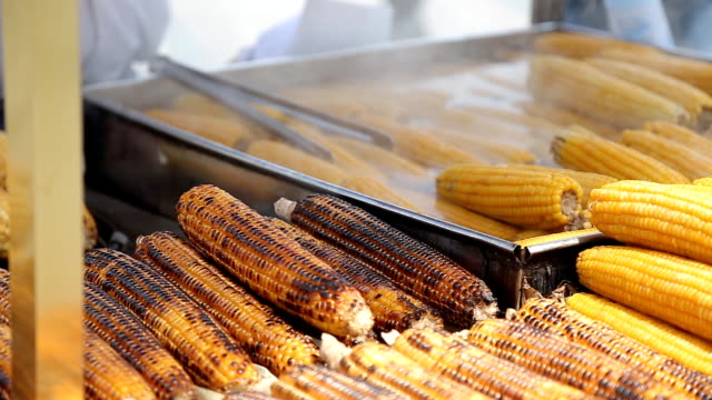 Grilled corn cob on the market in Turkey Grilled corn cob on the market seared stock videos & royalty-free footage