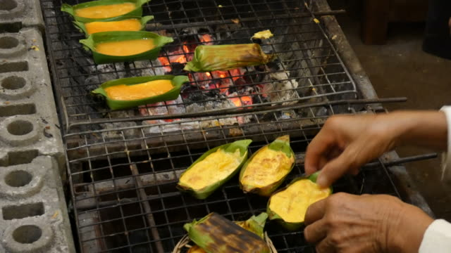 Grilled egg, street food, Thailand video