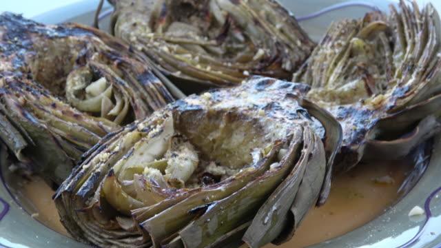 Grilled Garlic Seasoned Artichoke Halves. video