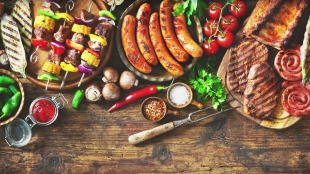 Grilled meat and vegetables on rustic wooden table Grilled meat and vegetables on rustic wooden table. Barbecue menu skewer stock videos & royalty-free footage