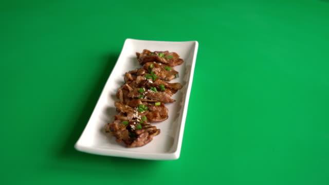 grilled pork - korean style - white background стоковые видео и кадры b-roll