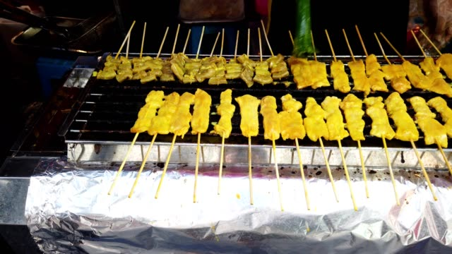 Grilled pork satay on stove street food in phuket town, popular street food in Thailand