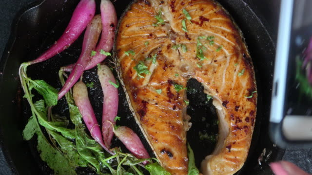 Grilled Salmon Fillet with Roasted Organic Radishes Healthy Ketonic Diet eating with roasted organic Radishes. Prepared and served in a rustic cast iron skillet. fillet stock videos & royalty-free footage
