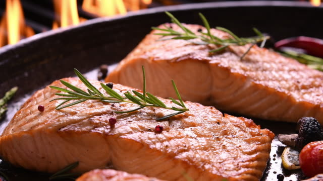Grilled salmon on pan on the flaming grill Grilled salmon on pan on the flaming grill fillet stock videos & royalty-free footage