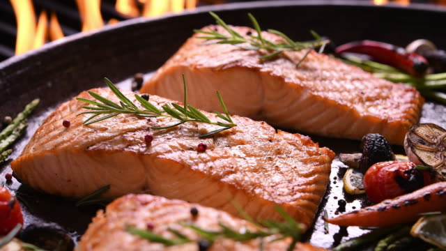 Grilled salmon on pan on the flaming grill Grilled salmon on pan on the flaming grill cooked stock videos & royalty-free footage
