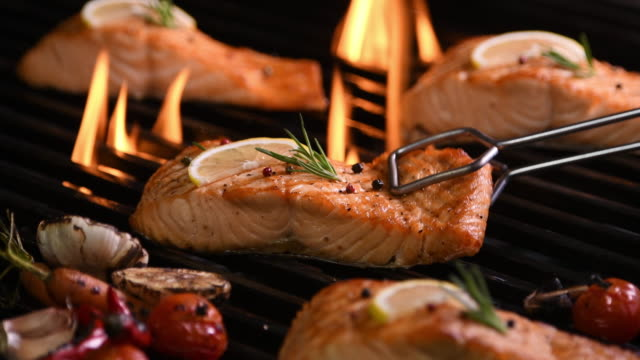 Grilled salmon on the flaming grill Grilled salmon on the flaming grill fillet stock videos & royalty-free footage