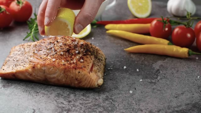 Grilled salmon served with lemon Grilled salmon served with lemon tasting stock videos & royalty-free footage