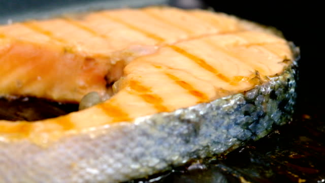 Grilled salmon steak on cast-iron grill pan video
