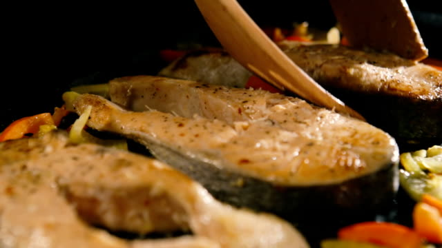 Grilled salmon steaks in cast iron pan video