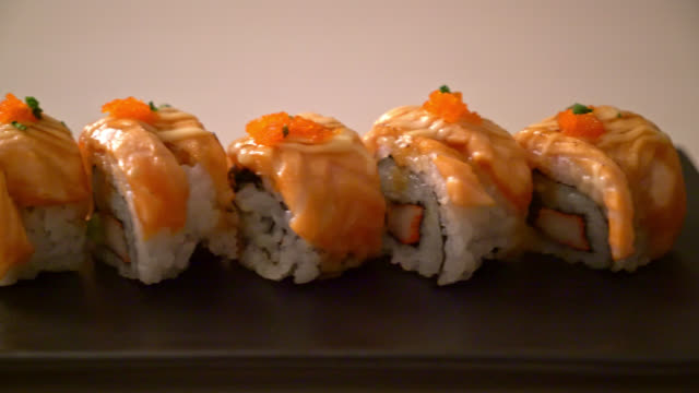 grilled salmon sushi roll with sauce grilled salmon sushi roll with sauce cooked stock videos & royalty-free footage