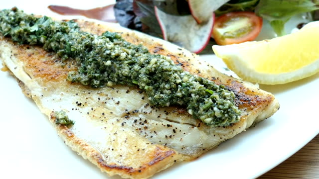 grilled sea bass fish meat steak with vegetable - filetto video stock e b–roll