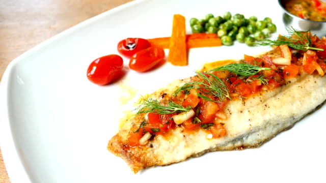 Grilled sea bass fish meat with sauce Grilled sea bass fish meat with sauce cooked stock videos & royalty-free footage