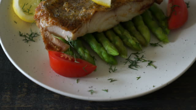 grilled snapper fish steak with vegetable grilled snapper fish steak with vegetable fillet stock videos & royalty-free footage