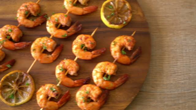 Grilled tiger shrimps skewers with lemon Grilled tiger shrimps skewers with lemon cooked stock videos & royalty-free footage