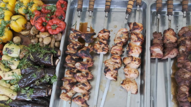 Grilled Vegetables and Meat in Street Shop Window. Food Court with Grilled Meals