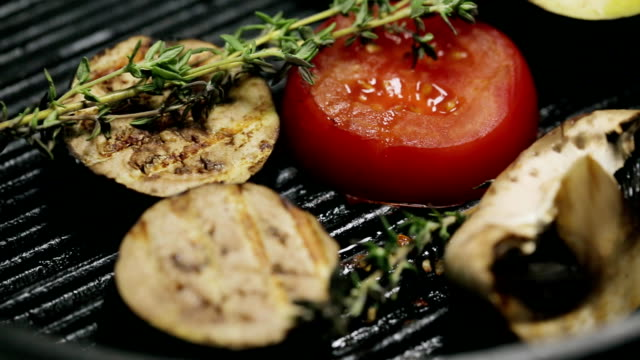 Grilled vegetables on the grill pan and theme video
