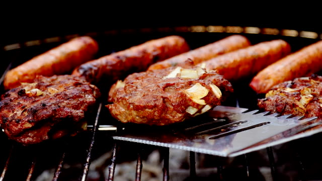 grilling and flipping burgers - memorial day stock videos & royalty-free footage