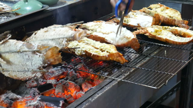 Grilling lobsters Grilling lobsters arthropod stock videos & royalty-free footage