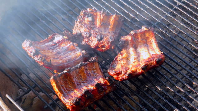 Grilling Ribs on Old Fashioned Charcoal Grill, Sunny Day video