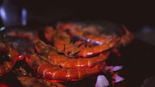 Grilling shrimps on barbecue. Hand puts the shrimp on grill. Grilled seafood on bbq at night party sea food festival. Cooking seafood on grill at home town. Grilling shrimps on barbecue. Hand puts the shrimp on grill. Grilled seafood on bbq at night party sea food festival. Cooking seafood on grill at home town. skewer stock videos & royalty-free footage