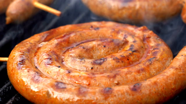 Grilling Tasty Sausages on Barbecue Grill - Zoom Out Street Vendor Selling Grilled Chicken and Pork Sausages. Appetizing Barbecue Sausages Cooking Over the hot Coals on a Barbecue Fire, Close up View. roast dinner stock videos & royalty-free footage
