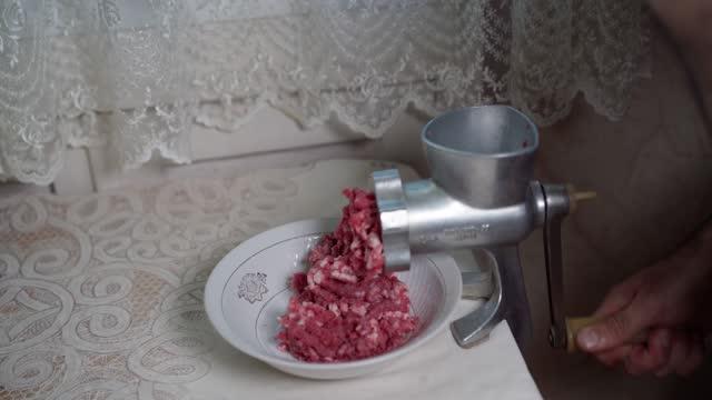 Grind meat through a meat grinder Grind meat through a meat grinder ground beef stock videos & royalty-free footage
