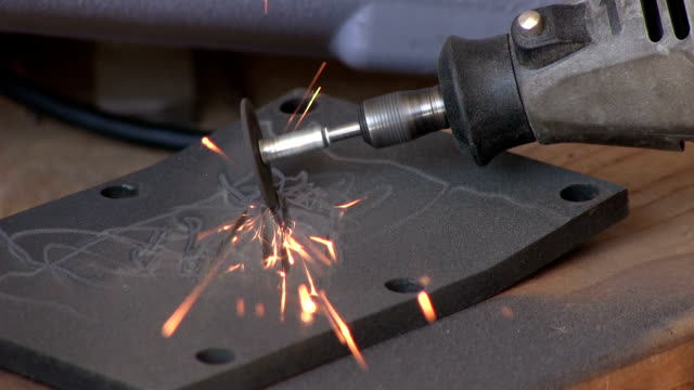 Grinder on metal with sparks close up with sound video