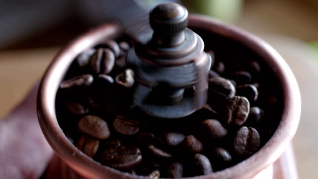 grinding coffee in a hand mill - grindare video stock e b–roll