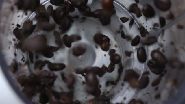 grinding coffee slow motion - grindare video stock e b–roll