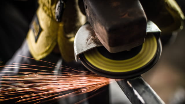 Grinding Machine Slow motion shot of a grinder. Sparks flying around. foundry stock videos & royalty-free footage