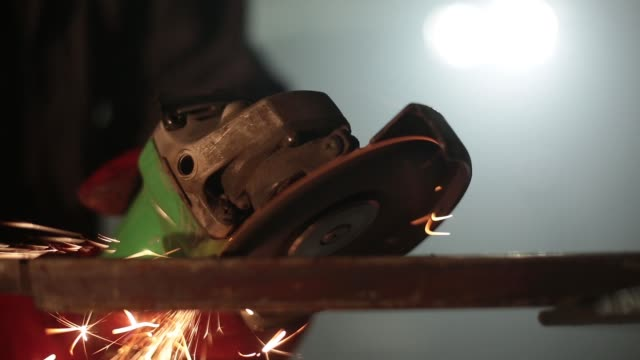 grinding metal and sparks. - rettificatrice video stock e b–roll