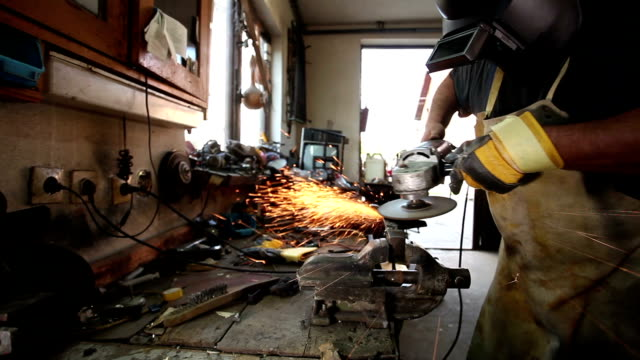 Grinding metal in old workshop video