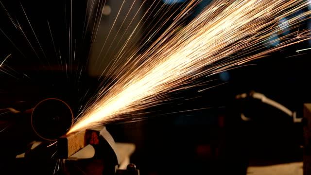 Grinding of metal part with circular saw.