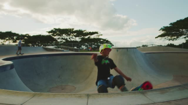 Grinding the pool coping Young skateboarder grinding the coping in a pool bowl, extreme shredder skateboarder kid in skatepark, slow motion skateboarding stock videos & royalty-free footage
