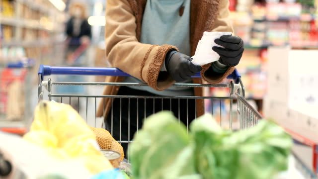 groceries during covid-19 - retail worker stock videos & royalty-free footage