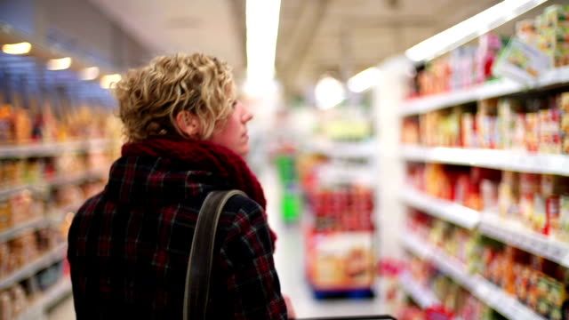 Grocery Shopping Woman shopping in a grocery store consumerism stock videos & royalty-free footage