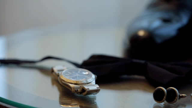 groom accessories watch, bow-tie, cufflinks and shoes