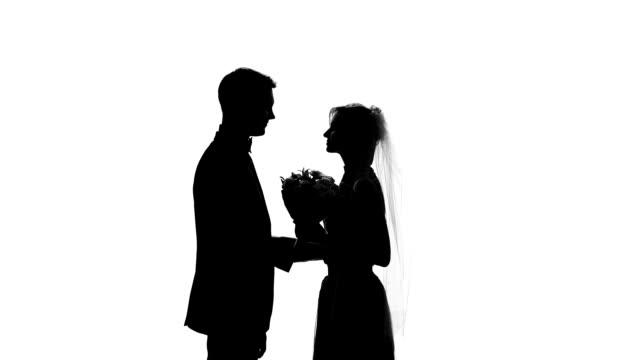 Groom and bride shadow kissing during wedding ceremony, romantic day, engagement