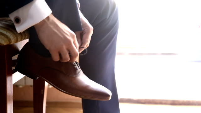 groom dressing up with classic elegant shoes. - wedding fashion stock videos and b-roll footage