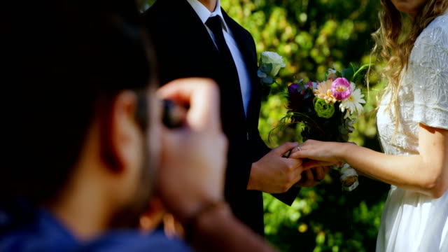 Groom holding bride hand and photographer taking photo 4K 4k video