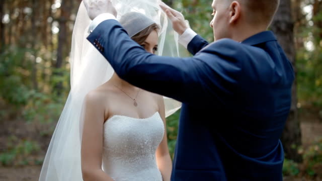 Groom up the veil of his bride video