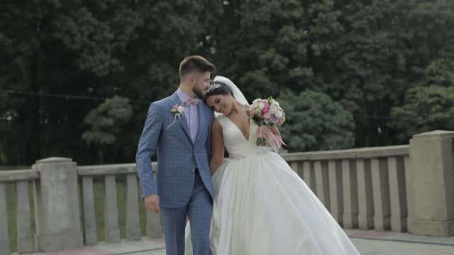 groom walking with bride. wedding couple. happy family. man and woman in love - rappresentazione umana video stock e b–roll
